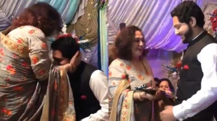 Mother-in-law Presents an AK-47 To Groom