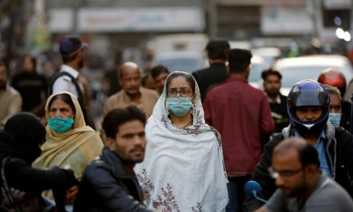 Woman wearing Mask in Market due to Covid-19